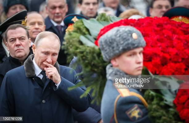 Russian President Vladimir Putin and Deputy Head of Russia's Security Counsil Dmitry Medvedev attend a wreathlaying ceremony at the Tomb of the...
