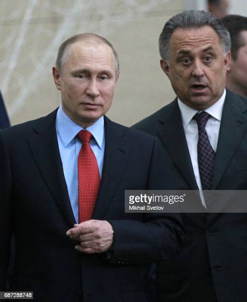 Russian President Vladimir Putin and Deputy Prime Minister Vitaly Mutko are seen while visiting the Football Academy on May 23 2017 in Krasnodar...