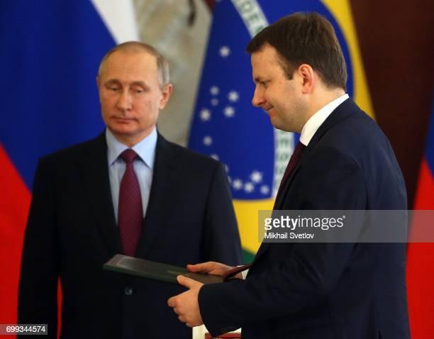 Russian President Vladimir Putin and Economic Development Minister Maksim Oreshkin attend RussianBrazilian talks at the Grand Kremlin Palace in...