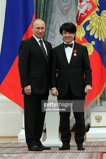 Russian President Vladimir Putin and fashion designer Valentin Yudashkin attend an awards ceremony at the Kremlin October 29, 2013 in Moscow, Russia....