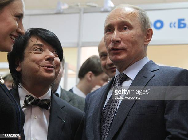 Russian President Vladimir Putin and fashion designer Valentin Yudashkin are seen visiting the Vologodsky textile, a linen industry plant on March 7,...