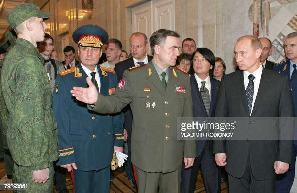 Russian President Vladimir Putin and fashion designer Valentin Yudashkin examine new uniforms at the defense ministry in Moscow, 28 January 2008. A...