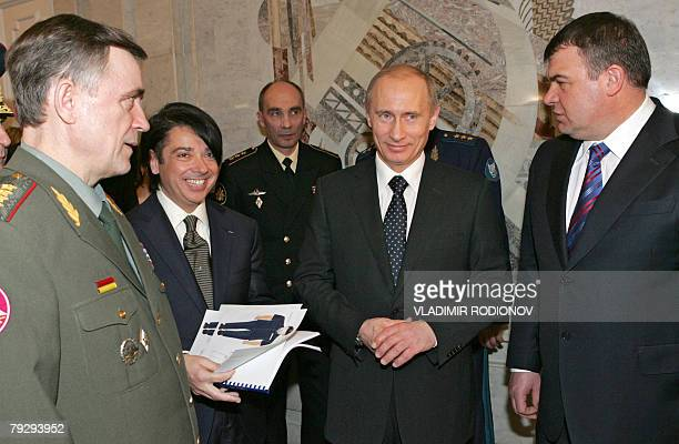Russian President Vladimir Putin and fashion designer Valentin Yudashkin examine new uniforms at the defence ministry in Moscow, 28 January 2008. At...