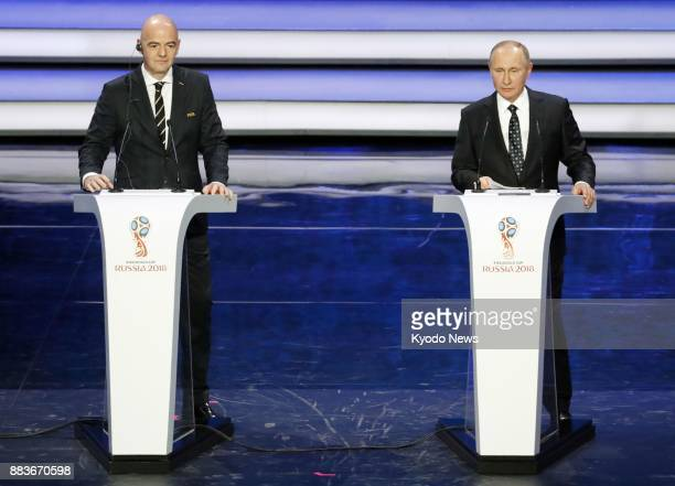 Russian President Vladimir Putin and FIFA President Gianni Infantino on stage at the concert hall of the State Kremlin Palace in Moscow on Dec 1...