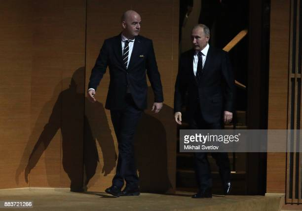 Russian President Vladimir Putin and FIFA President Gianni Infantino attend the Final Draw of 2018 FIFA World Cup at State Kremlin Palace in Moscow...