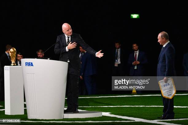 Russian President Vladimir Putin and FIFA president Gianni Infantino attend the 68th FIFA Congress at the Expocentre in Moscow on June 13 2018