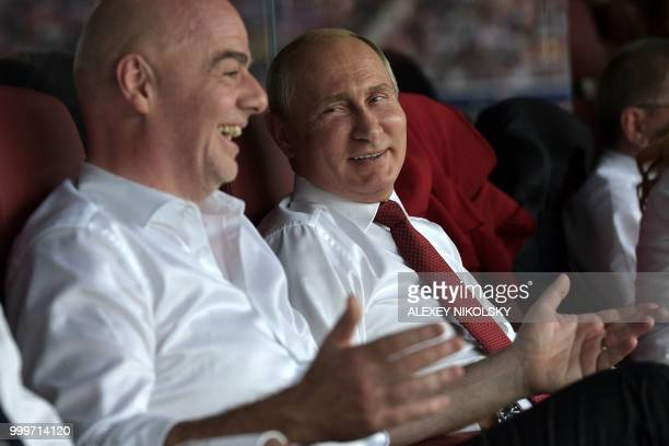 TOPSHOT Russian President Vladimir Putin and FIFA president Gianni Infantino attend the Russia 2018 World Cup final football match between France and...