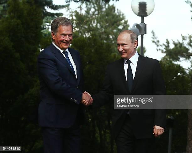 Russian President Vladimir Putin and Finland's President Sauli Niinisto meet at the Kultaranta residence on July 1 2016 in Naantali Finland Putin is...