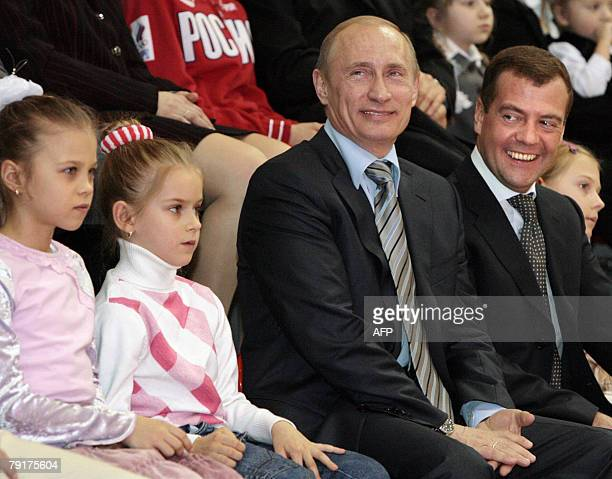 Russian President Vladimir Putin and First Deputy Prime Minister and presidential candidate Dmitry Medvedev smile during their visit to the sport...