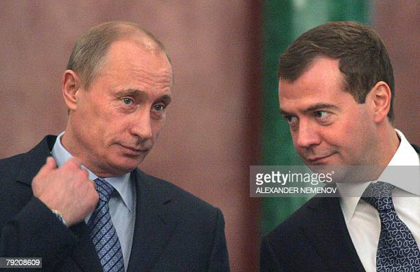 Russian President Vladimir Putin and First Deputy Prime Minister and presidential candidate Dmitry Medvedev speak during a document signing ceremony...