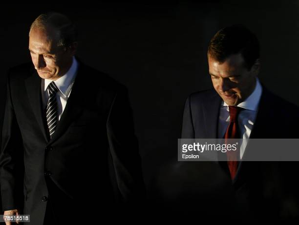 Russian President Vladimir Putin and First Deputy Prime Minister Dmitry Medvedev enter the congress of the United Russia party on December 17 2007 in...
