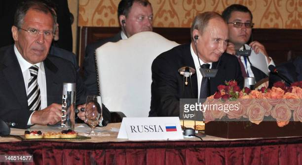 Russian President Vladimir Putin and Foreign Minister Sergei Lavrov attend a BRICS's Presidents meeting in Los Cabos Mexico on June 18 before the...