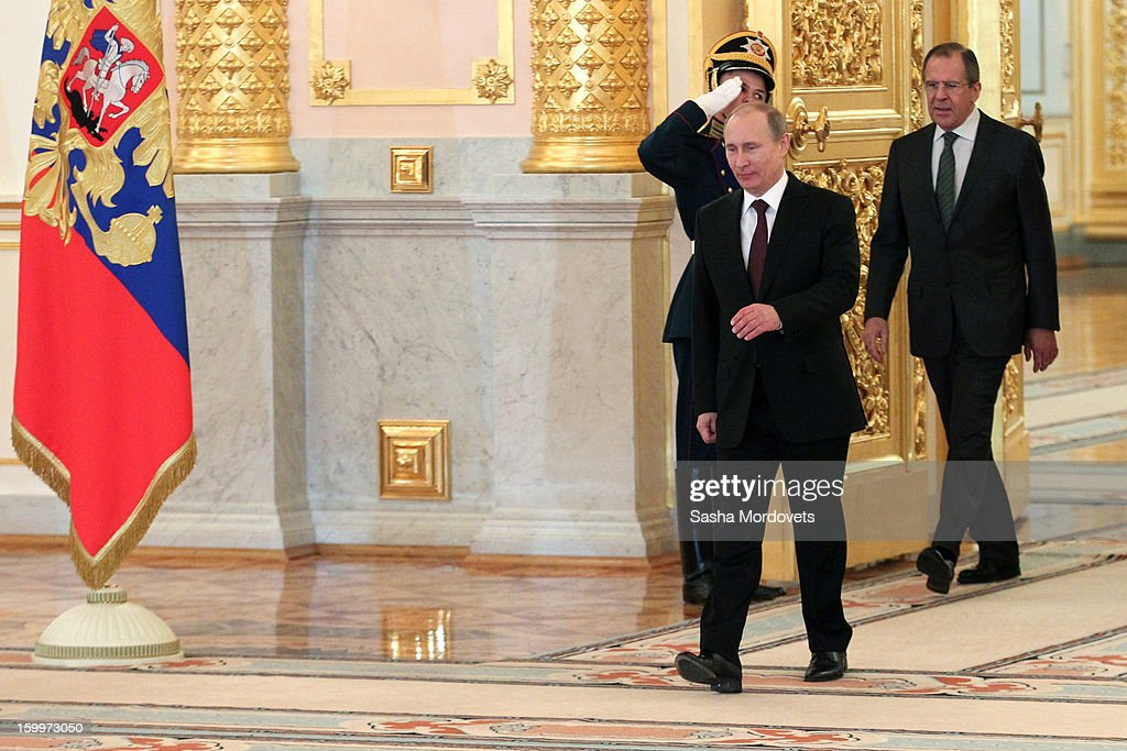 Russian President Vladimir Putin (C) and Foreign minister Sergey Lavrov (R) arrive at a reception for new ambassadors in the Alexander Hall of the Grand Kremlin Palace January 24, 2013 in Moscow, Russia. Putin received 20 new foreign ambassadors.