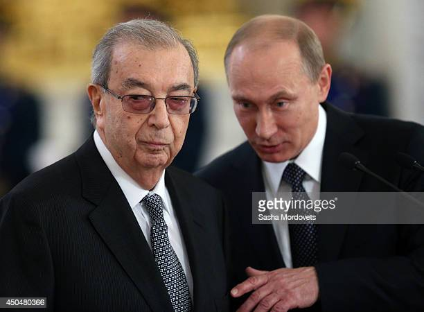 Russian President Vladimir Putin and Former Prime Minister Yevgeny Primakov are seen during the State Awards Ceremony during celebration of the Day...
