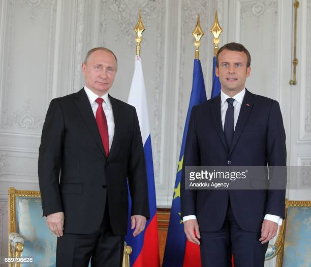 Russian President Vladimir Putin and France's President Emmanuel Macron hold a press conference after their meeting in Paris France on May 29 2017