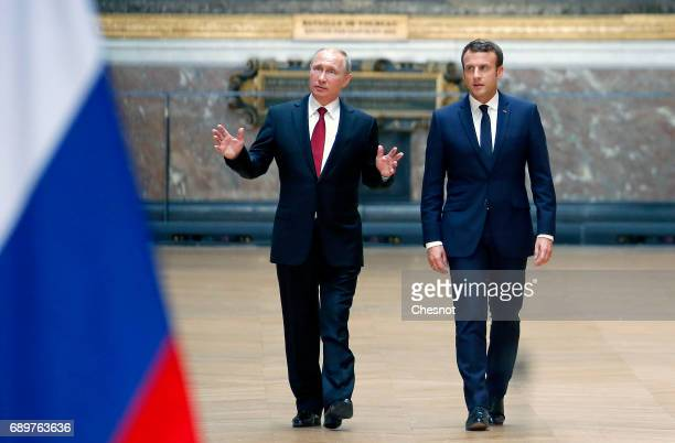 Russian President Vladimir Putin and French President Emmanuel Macron arrive to hold a joint press conference at 'Chateau de Versailles' on May 29...