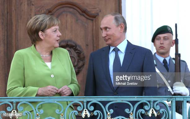 Russian President Vladimir Putin and German Chancellor Angela Merkel attend their meeting at Meseberg governmental house in Gransee outside of Berlin...