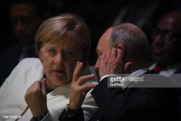 Russian President Vladimir Putin and German Chancellor Angela Merkel at the opening session of the Paris Peace Forum an event that is a part of the...