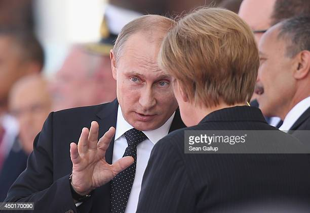 Russian President Vladimir Putin and German Chancellor Angela Merkel attend the main international ceremony with 17 heads of state at Sword Beach on...