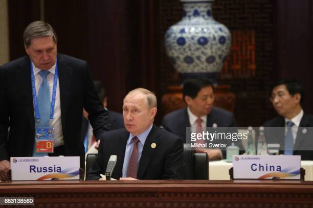 Russian President Vladimir Putin and his aide Yuri Ushakov attend the rountable plenary meeting during the Belt and Road Forum for International...