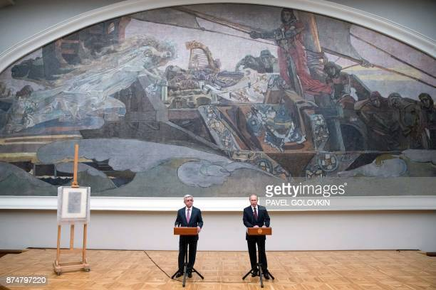 Russian President Vladimir Putin and his Armenian counterpart Serzh Sargsyan speak in front of guests as they visit the exhibition of Armenian...