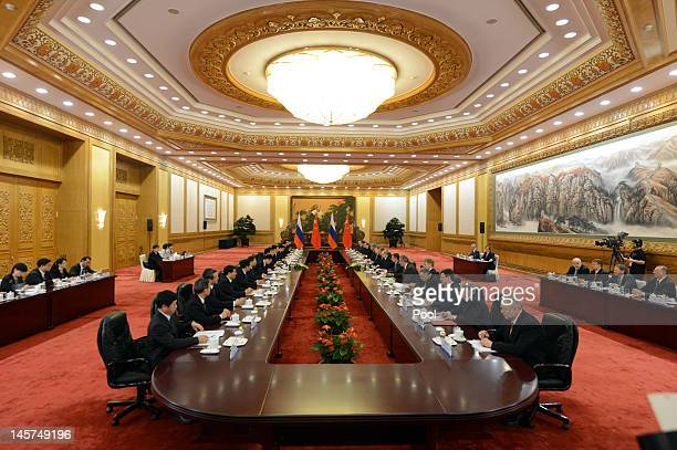 Russian President Vladimir Putin and his delegation meet with Chinese President Hu Jintao after a welcoming ceremony for the Shanghai Cooperation...
