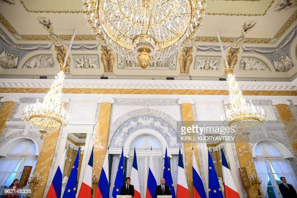 Russian President Vladimir Putin and his French counterpart Emmanuel Macron give a joint press conference following their talks at the Konstantin...