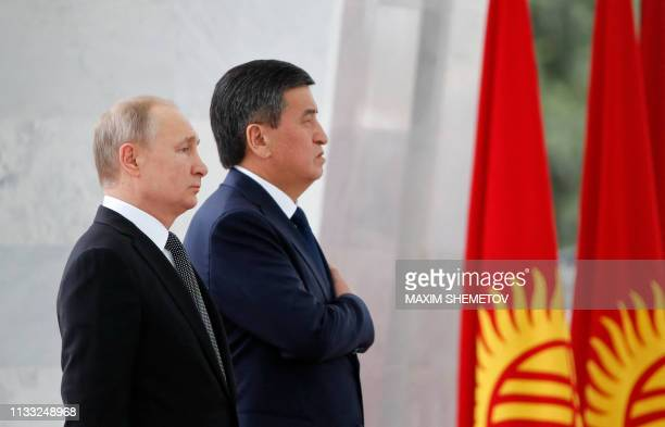 Russian President Vladimir Putin and his Kyrgyz counterpart Sooronbay Jeenbekov take part in a welcoming ceremony ahead of their talks in Bishkek on...