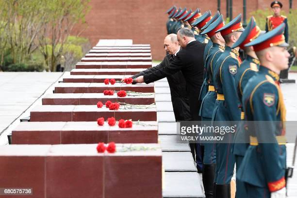 TOPSHOT Russian President Vladimir Putin and his Moldovan counterpart Igor Dodon attend a wreath laying ceremony marking the 72nd anniversary of the...