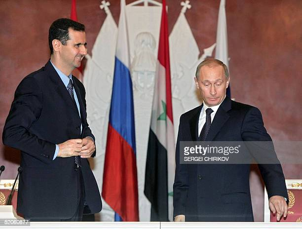 Russian President Vladimir Putin and his Syrian counterpart Bashar alAssad are seen during a signing ceremony in the Moscow's Kremlin 25 January 2005...