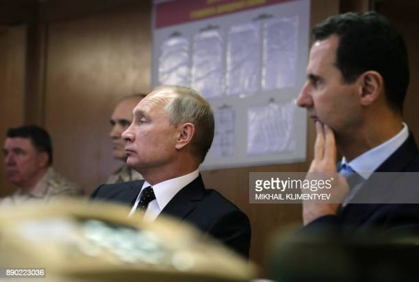 Russian President Vladimir Putin and his Syrian counterpart Bashar alAssad attend a meeting with Russian military officers during their visit to the...