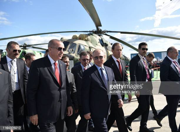 Russian President Vladimir Putin and his Turkish counterpart Recep Tayyip Erdogan walk as they visit the MAKS 2019 International Aviation and Space...