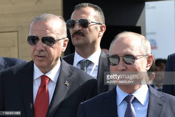 Russian President Vladimir Putin and his Turkish counterpart Recep Tayyip Erdogan visit the MAKS-2019 International Aviation and Space Salon opening...