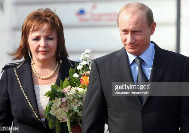 Russian President Vladimir Putin and his wife Ludmila Alexandrowa Putina arrive at the airport on June 6 2007 in RostockLaage Germany Putin along...