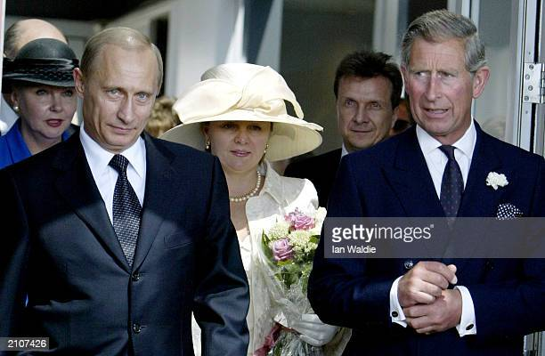 Russian President Vladimir Putin and his wife Ludmila are greeted by the Prince of Wales as he arrives in Britain at Heathrow airport for a fourday...