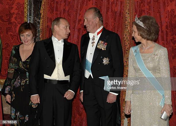 Russian President Vladimir Putin and his wife Lyudmila pose with Spain's King Juan Carlos and Queen Sofia at an official dinner in honour of Russian...