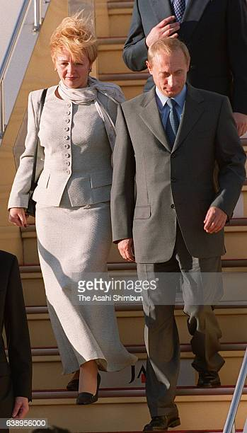 Russian President Vladimir Putin and his wife Lyudmila Putin are seen on arrival at Haneda International Airport on September 3 2000 in Tokyo Japan