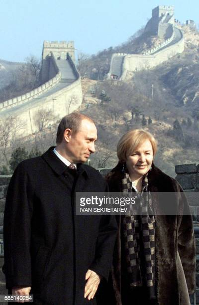 Russian President Vladimir Putin and his wife Lyudmila stand looking at the Great Wall of China, the most ancient parts of which were erected in the...