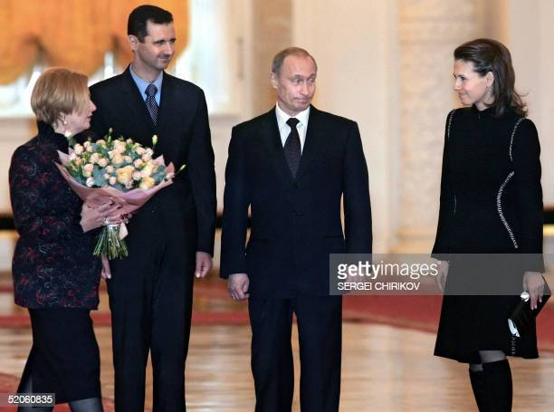 Russian President Vladimir Putin and his wife Lyudmila welcome Syrian President Bashar alAssad and his wife Asma before their meeting in the Moscow's...