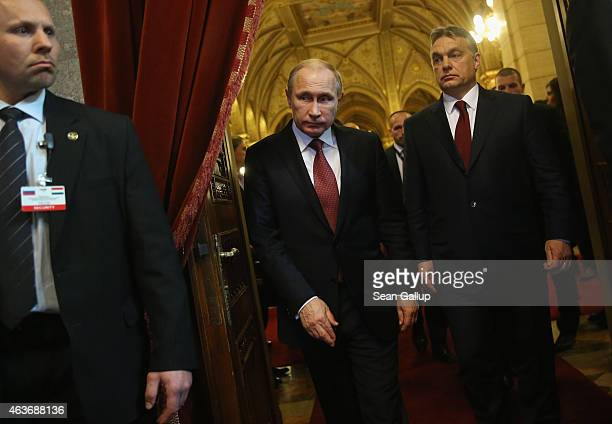 Russian President Vladimir Putin and Hungarian Prime Minister Viktor Orban arrive to speak to the media following lengthy talks at Parliament on...