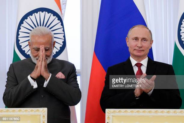 Russian President Vladimir Putin and Indian Prime Minister Narendra Modi attend a signing ceremony following their meeting on the sidelines of the St...
