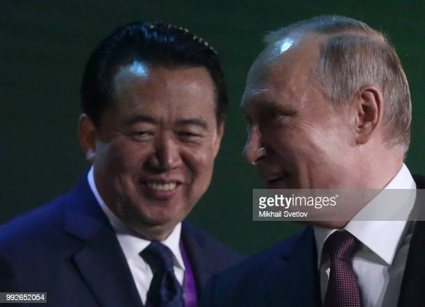 Russian President Vladimir Putin and Interpol Director Meng Hongwei attend the International Cyber Security Congress on July 6 2018 in Moscow Russia