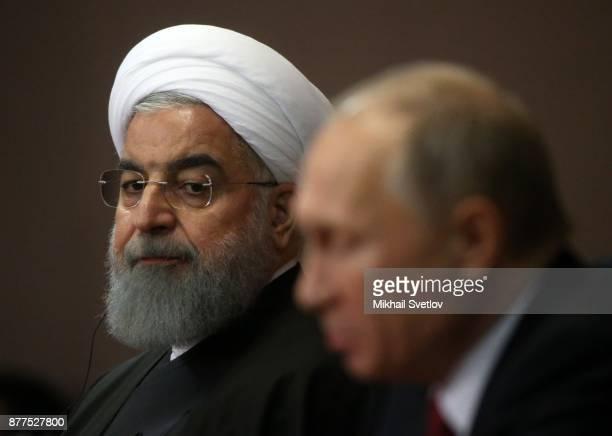 Russian President Vladimir Putin and Iranian President Hassan Rouhani are seen during their RussianTurkishIranian talks at Black Sea resort of Sochi...