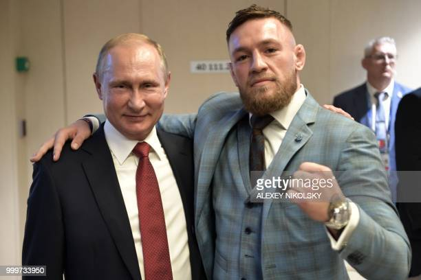 Russian President Vladimir Putin and Irish Mixed Martial Arts fighter Conor McGregor pose after the first half of the Russia 2018 World Cup final...