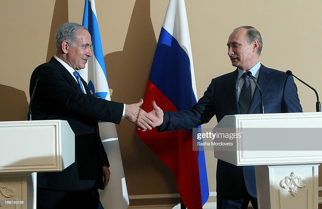 Russian President Vladimir Putin (R) and Israeli Prime Minister Benjamin Netanyahu shake hands as they hold a joint press conference at Bocharov Ruchei state residence on May 14, 2013 in Sochi, Russia. According to reports, Israel's concerns over Russian plans to sell Syrian President Bashar al-Assad an advanced air defense system will be raised.