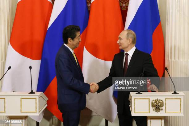 Russian President Vladimir Putin and Japanese Prime Minister Shinzo Abe shakes hands during their press conference at the Kremlin on January 22 2019...