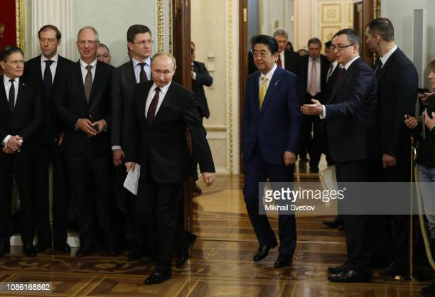Russian President Vladimir Putin and Japanese Prime Minister Shinzo Abe arrive for their press conference at the Kremlin on January 22 2019 in Moscow...
