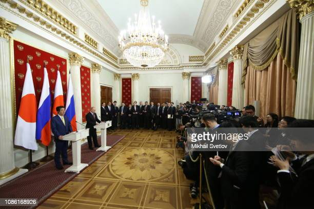 Russian President Vladimir Putin and Japanese Prime Minister Shinzo Abe speak during their press conference at the Kremlin on January 22 2019 in...