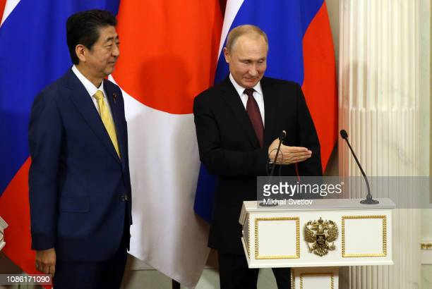 Russian President Vladimir Putin and Japanese Prime Minister Shinzo Abe shake hands during their press conference at the Kremlin on January 22 2019...