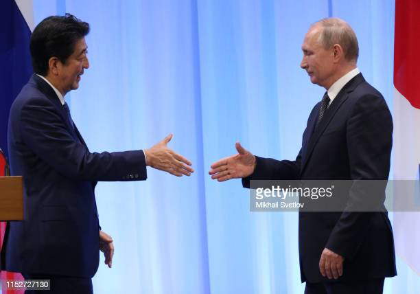 Russian President Vladimir Putin and Japanese Prime Minister Shinzo Abe attend their meeting at the G20 Osaka Summit 2019 in Osaka Japan June2019...